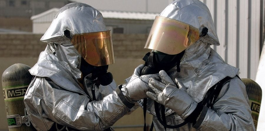 men wearing asbestos protection gear