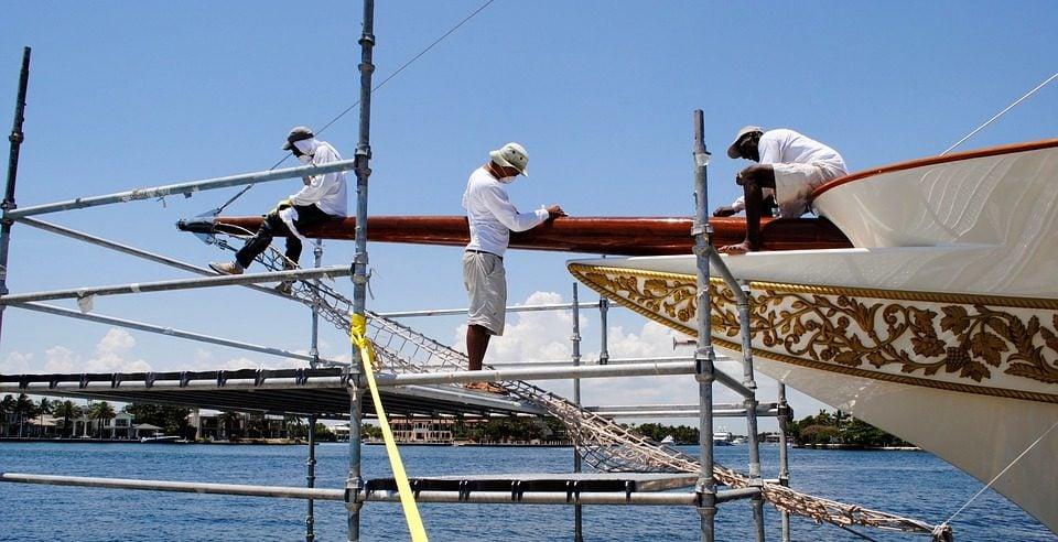 ship workers repairing ship