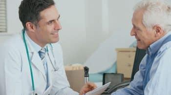 doctor talking to an elderly man