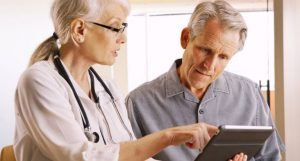 patient doctor looking at tablet