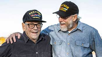 two veterans taking a photo